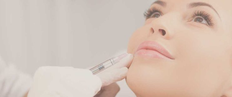 Woman preparing for lip injections by APT Medical Aesthetics