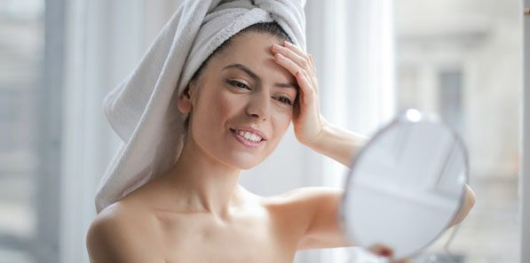 Happy woman after seeing the results of her at home chemical peel