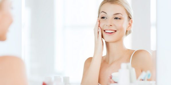 Woman with healthy skin after regular maintenance with at home skincare.