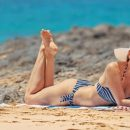 Woman sunbathing in the beach