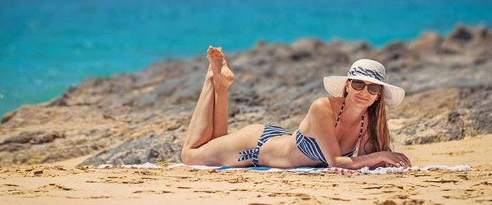 Woman sunbathing in the beach