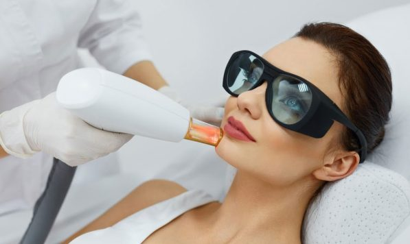 Female patient getting laser skin resurfacing treatment on the chin
