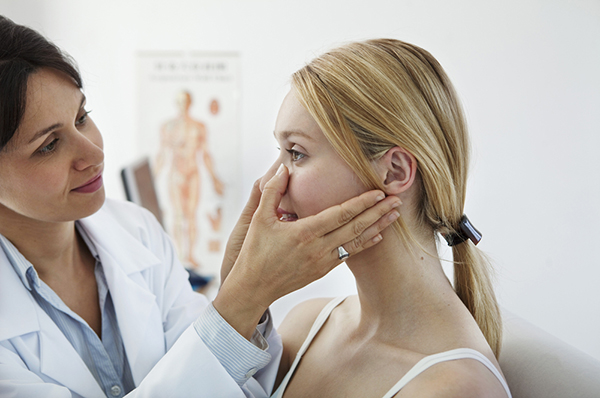 Cosmetic doctor evaluating a female patient