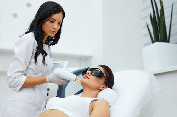 Female patient going through laser skin resurfacing treatment
