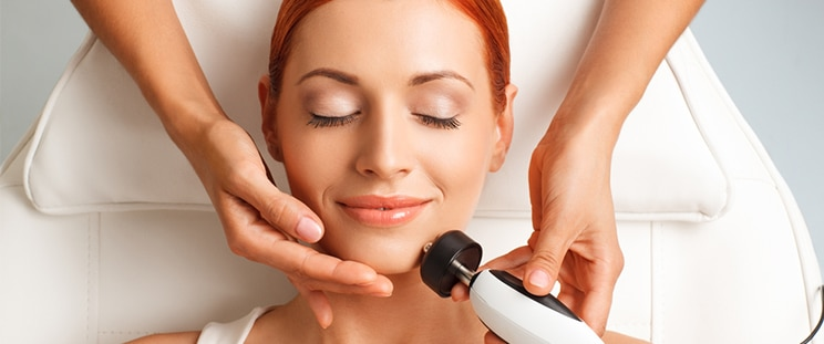 A woman gets a radiofrequency skin lifting treatment