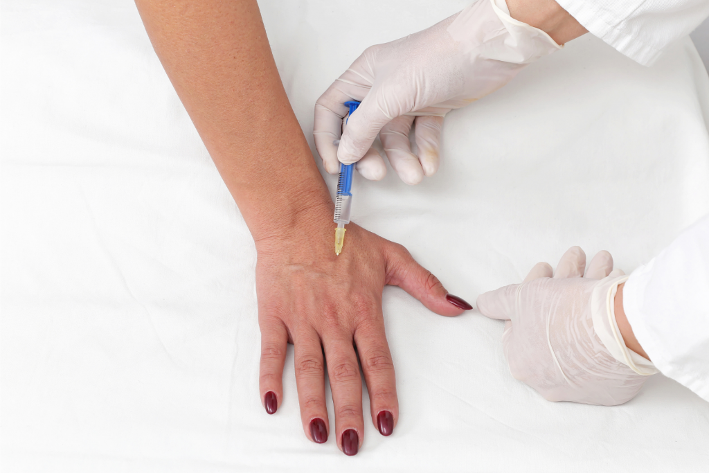 a woman getting Botox injections on her hand