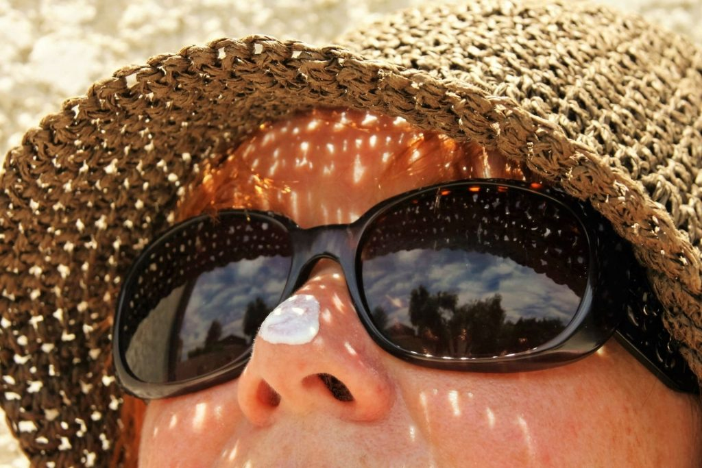 drop of sunscreen on a woman's nose