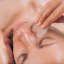 Close up of a woman having a Gua Sha facial